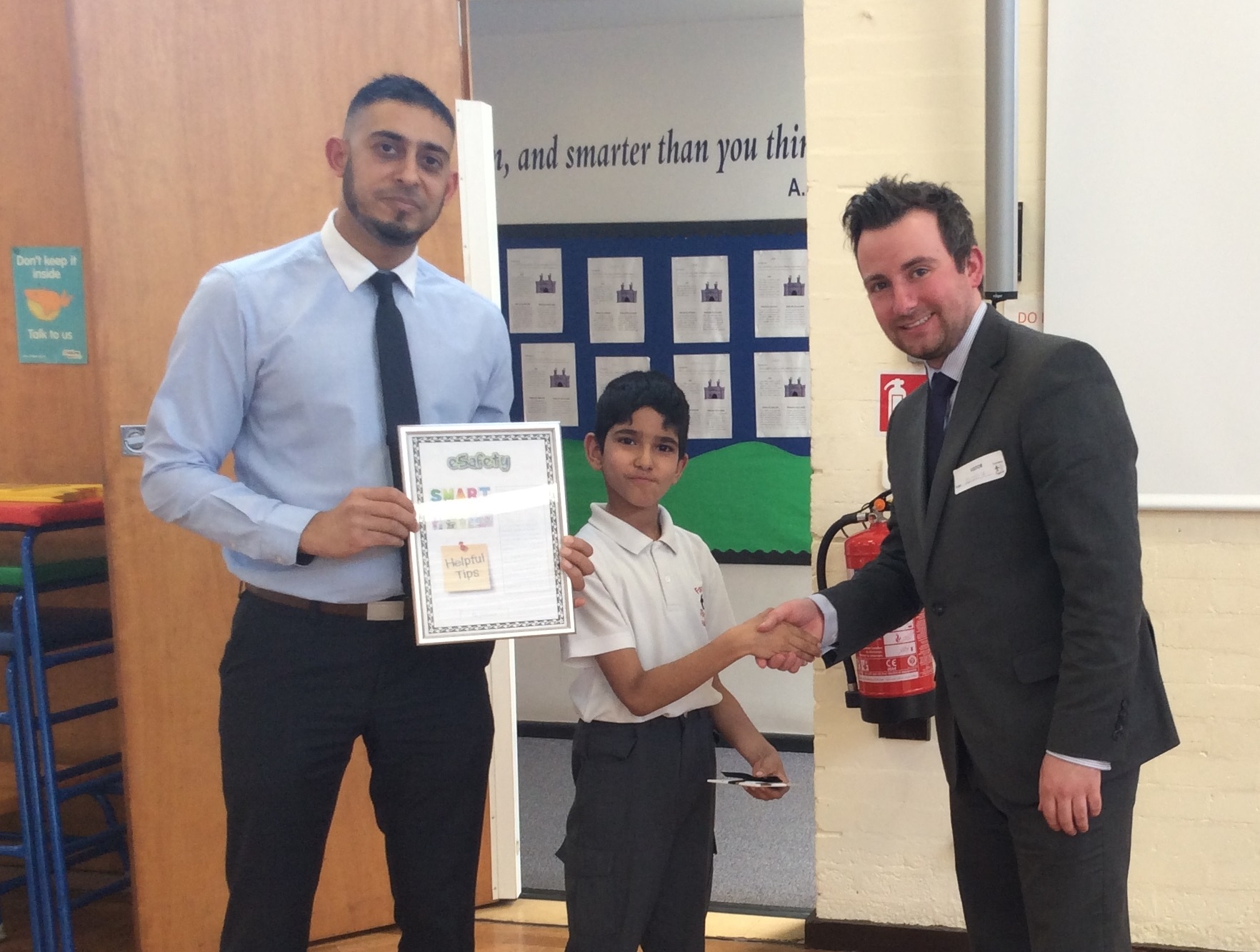 3rd place Jatinder from Hargate Primary School receiving prize form Alex Cox, PK Education and teacher, Mr Anwar