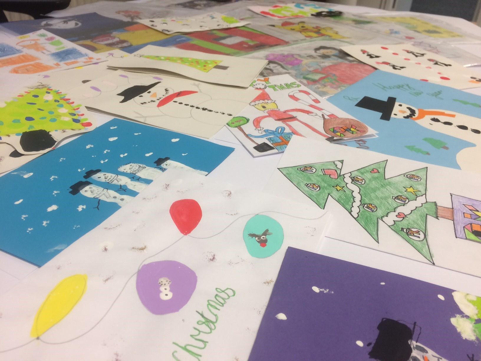 Christmas card entries spread across desk